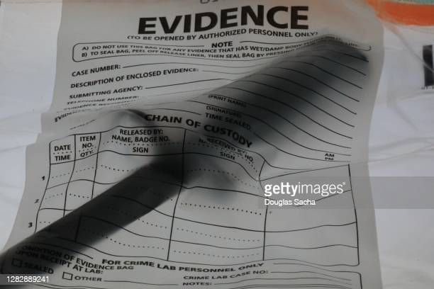 knife recovered from a crime scene for evidence - evidence bag stock pictures, royalty-free photos & images