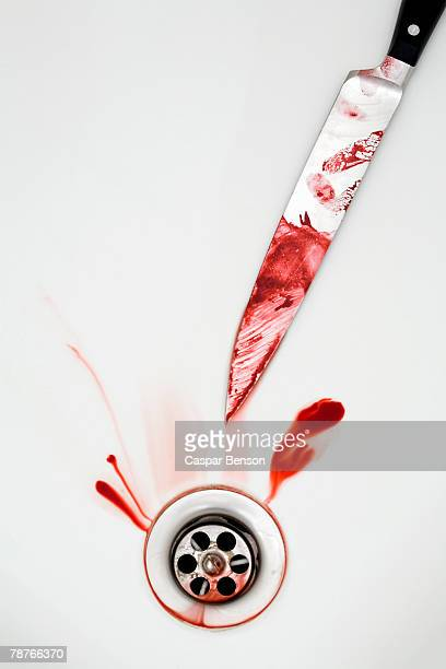 A knife with blood in the bath