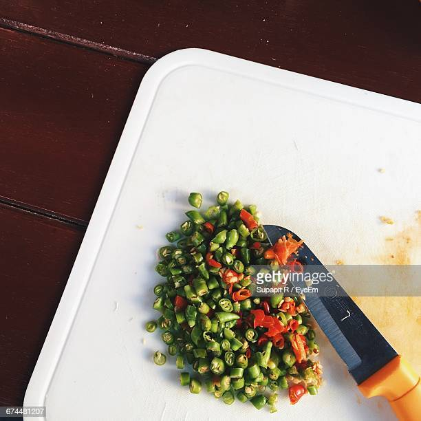 Knife With Chopped Chilli On Cutting Board