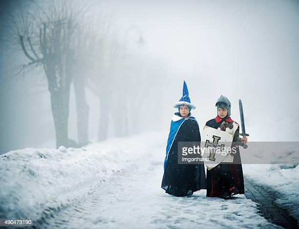 knight and wizard on a scary winter quest - period costume stock pictures, royalty-free photos & images