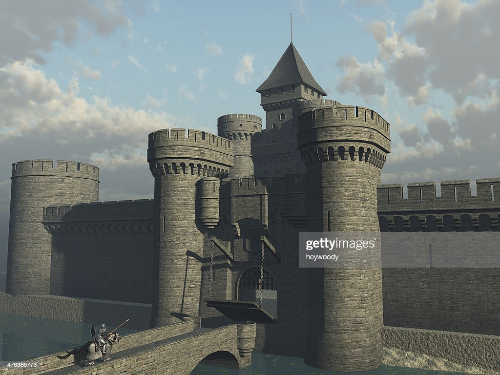 Knight approaching castle gate : Stock Photo