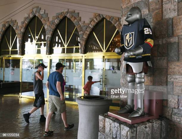 A knight at the Excalibur Hotel Casino wears a jersey of goaltender MarcAndre Fleury of the Vegas Golden Knights the day after the team won the...