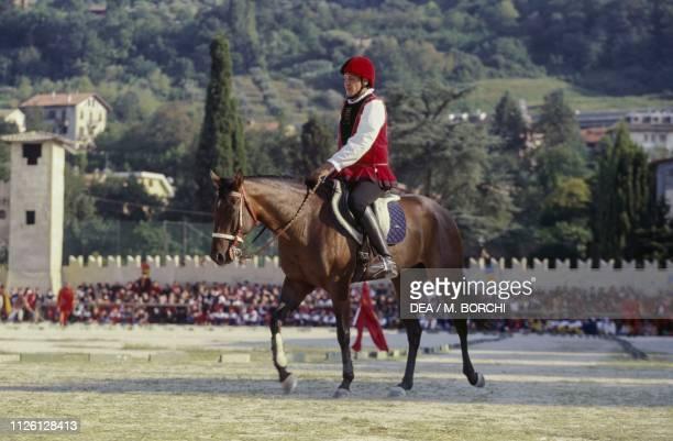 Knight during a joust in the tournament field Giostra della Quintana jousting tournament in Ascoli Piceno Marche Italy