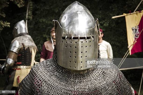 Knight wearing a helmet and chain mail 14th century Historical reenactment