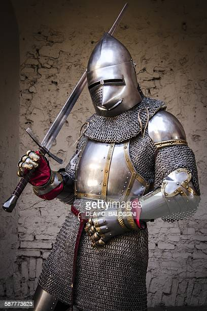 Knight with armour chain mail and sword 14th century Historical reenactment Detail