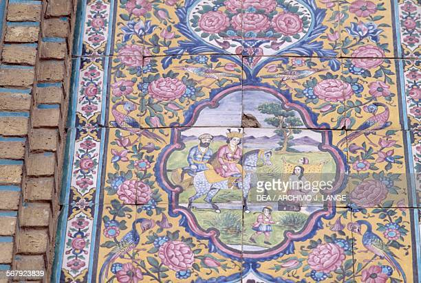 Knight, woman and child, polychrome tile decoration on the front of Qavam house also known as Narenjestan e Ghavam, 1879-1886, in the Eram garden or...