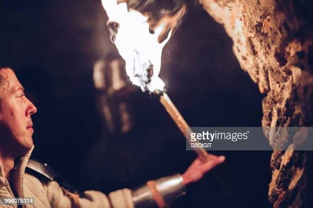 knights and fire - cave fire stock photos and pictures