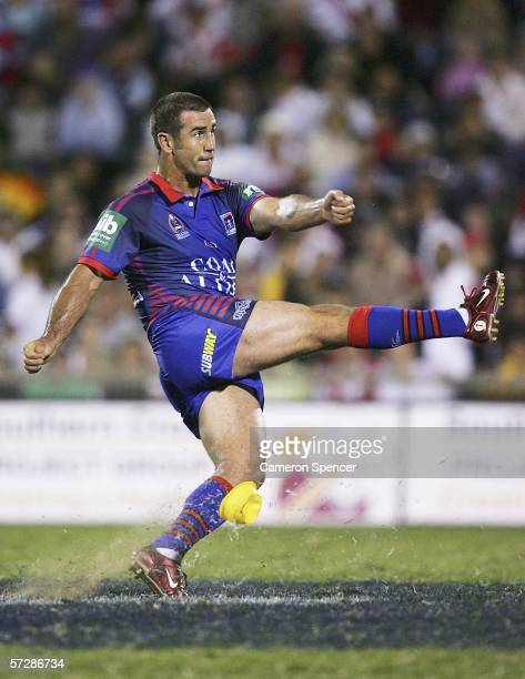 Knights captain Andrew Johns kicks for goal during the round five NRL match between the St George Illawarra Dragons and the Newcastle Knights at WIN...