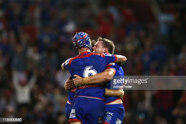 Knights celebrate a try from Tim Glasby during round one NRL match between the Newcastle Knights and the CronullaSutherland Sharks at McDonald Jones...