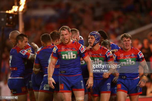 Knights celebrate a try from Tim Glasby during round one NRL match between the Newcastle Knights and the Cronulla-Sutherland Sharks at McDonald Jones...