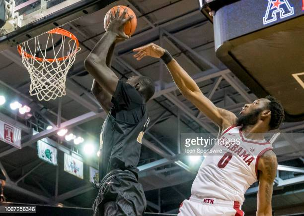 Knights center Tacko Fall dunks the ball during the basketball game between the UCF Knights and the and Alabama Crimson Tide on November 29 2018 at...