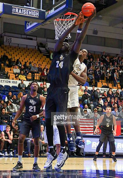 Knights center Tacko Fall gets over the basket defended by George Washington Colonials forward Kevin Marfo during a NCAA men's Div 1 basketball game...