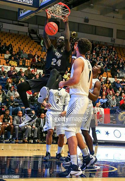 Knights center Tacko Fall scores during a NCAA men's Div 1 basketball game on December 15 at the Smith Center in Washington DC George Washington...