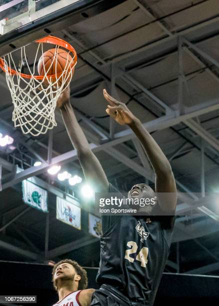Knights center Tacko Fall tips the ball in during the basketball game between the UCF Knights and the and Alabama Crimson Tide on November 29 2018 at...