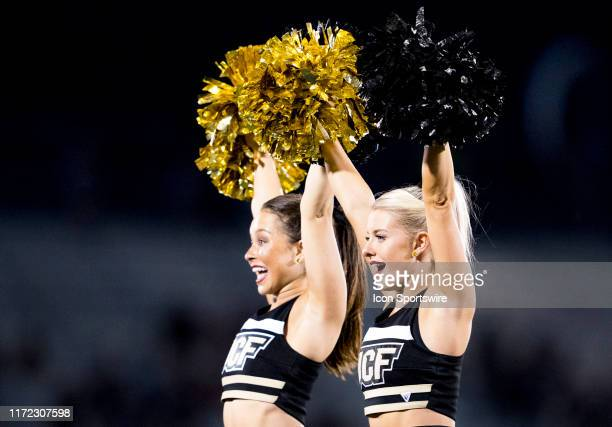 Knights cheerleaders celebrate a touchdown during the football game between the UCF Knights and the UConn Huskies on September 28 2019 at Bright...