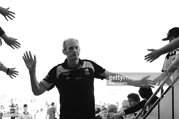 Knights coach Wayne Bennett acknowledges fans after the round 17 NRL match between the Canterbury Bulldogs and the Newcastle Knights at Virgin...