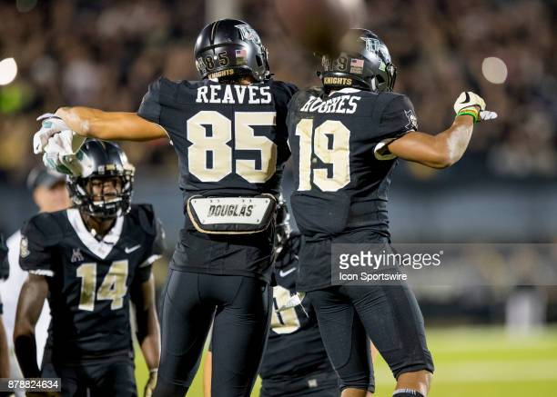 Knights defensive back Mike Hughes celebrates his 95 yard return to assure the UCF Knights win during the football game between the UCF Knights and...