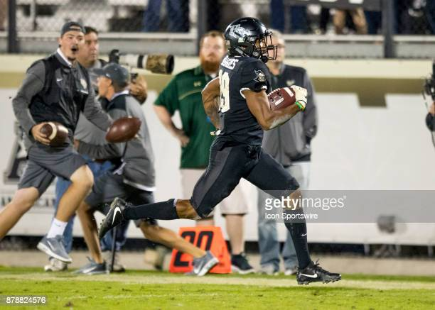Knights defensive back Mike Hughes returns a 95 yard kickoff to assure the UCF Knights win during the football game between the UCF Knights and USF...