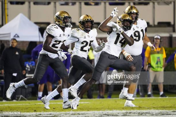 Knights defensive back Nevelle Clarke celebrates with teammates after intercepting a pass during a game between the UCF Knights and the East Carolina...