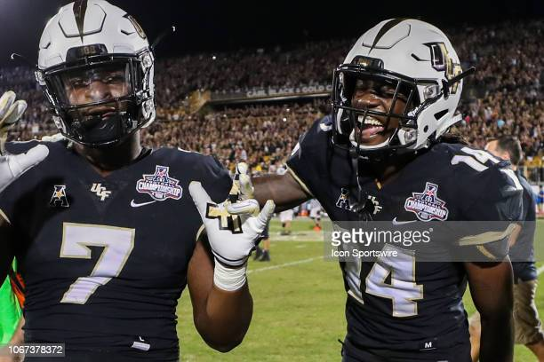 Knights defensive lineman Kenny Turnier and UCF Knights defensive back Nevelle Clarke celebrate after winning the AAC Championship football game...