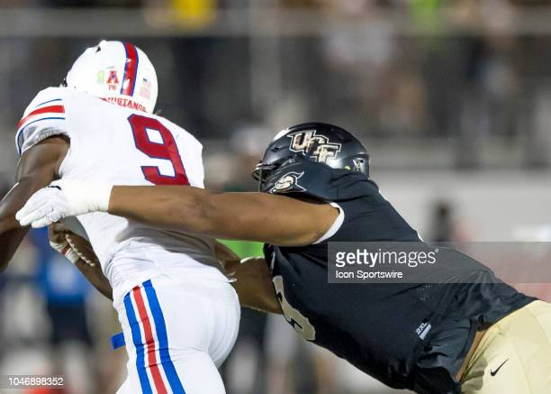 Knights defensive lineman Trysten Hill sacks Southern Methodist Mustangs quarterback William Brown during the football game between the UCF and SMU...
