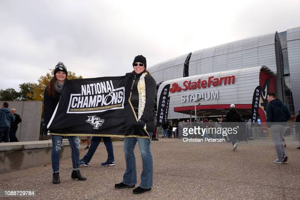 Knights fans pose for a photo outside State Farm Stadium before the PlayStation Fiesta Bowl between LSU and Central Florida on January 01 2019 in...
