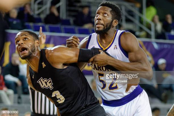Knights forward AJ Davis boxes out East Carolina Pirates guard Justice Obasohan during a game between the East Carolina Pirates and the University of...