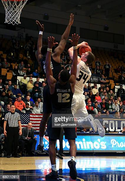 Knights forward Chad Brown defends against George Washington Colonials forward Tyler Cavanaugh during a NCAA men's Div 1 basketball game on December...