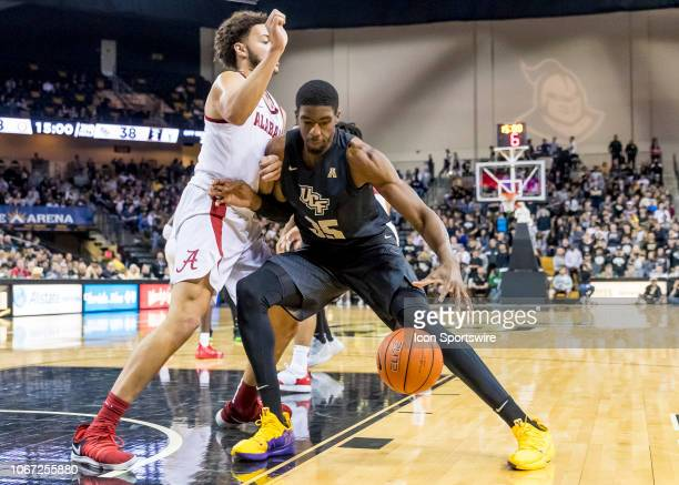 Knights forward Collin Smith drives to the paint during the basketball game between the UCF Knights and the and Alabama Crimson Tide on November 29...