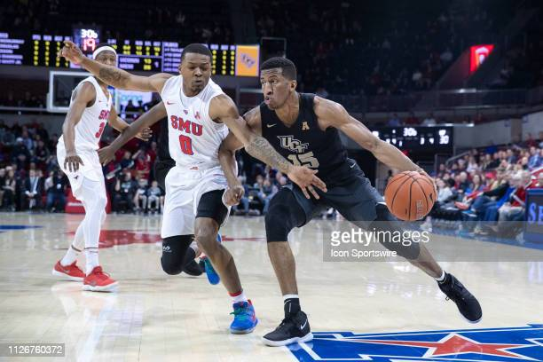 Knights guard Aubrey Dawkins drives to the basket as SMU Mustangs guard Jahmal McMurray defends during the American Athletic Conference college...