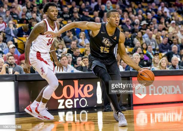 Knights guard Aubrey Dawkins looks to pass the ball during the basketball game between the UCF Knights and the and Alabama Crimson Tide on November...