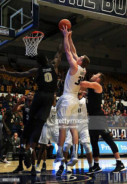 Knights guard Tanksley Efianayi defends against George Washington Colonials forward Tyler Cavanaugh during a NCAA men's Div 1 basketball game on...