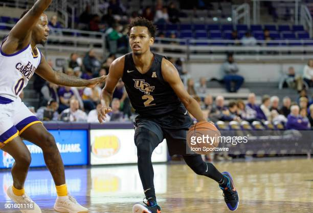Knights guard Terrell Allen drives to the basket during a game between the East Carolina Pirates and the University of Central Florida Knights at...