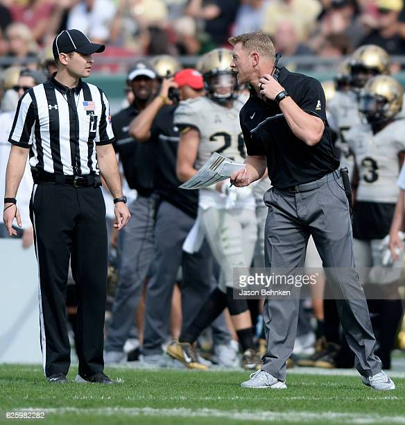 Knights head coach Scott Frost talks with a official during the second quarter at Raymond James Stadium on November 26 2016 in Tampa Florida