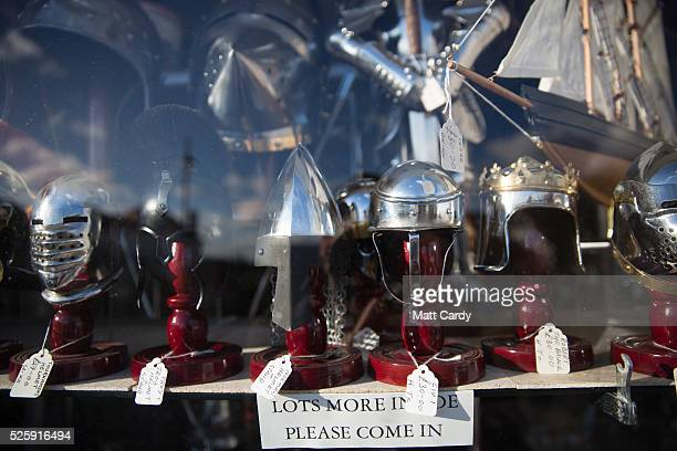 Knights helmets and armour is displayed in the window of a shop in Tintagel on April 27 2016 in Cornwall England The English Heritage managed site...