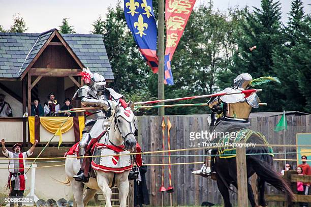 Knights in Costume Armour and Riding Horses Enter the Ring and Strike Their Opponent With a Lance Weapon During a Reenactment Martial Jousting Battle...