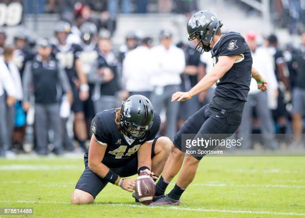 Knights kicker Matthew Wright kicks an extra point during the football game between the UCF Knights and USF Bulls on November 24 2017 at Bright House...