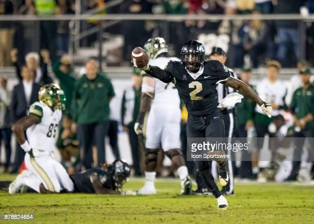 Knights linebacker Chequan Burkett recovers the fumble during the football game between the UCF Knights and USF Bulls on November 24 2017 at Bright...