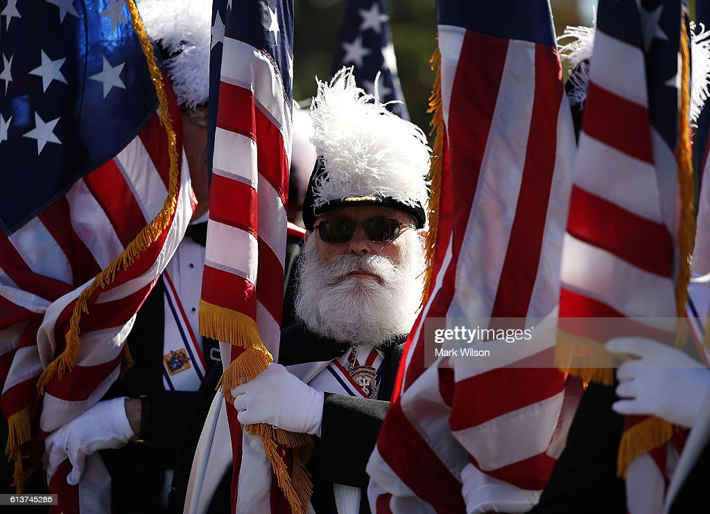 Knights of Columbus member, Dick Bissel holds an Amerian flag during a Columbus Day ceremony at the National Columbus Memorial in front of Union Station, October 10, 2016 in Washington, DC. Columbus Day celebrates Christopher Columbus' arrival in the Americas on October 12, 1492.