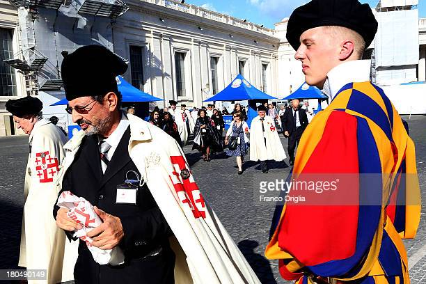 Knights of Holy Sepulchre from all over the world arrive at the Paul VI Hall for an audience with Pope Francis on September 13 2013 in Vatican City...