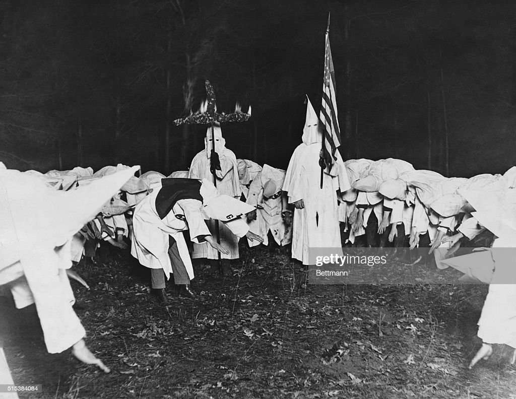 Klu klux klan rally pictures getty images knights of the klu klux klan saluting the american flag and the fiery cross inseparable biocorpaavc Images