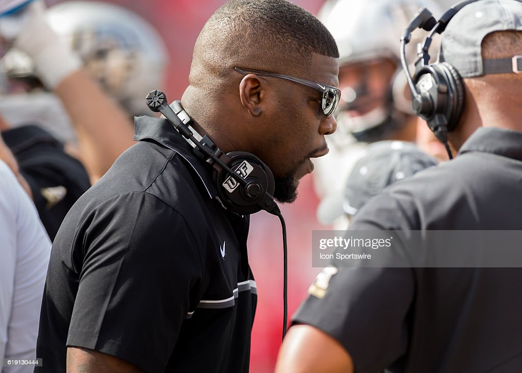 UFC Knights offensive coordinator Troy Walters instructs players during the NCAA football game between the Central Florida Knights and Houston Cougars on October 29, 2016 at TDECU Stadium in Houston, TX.