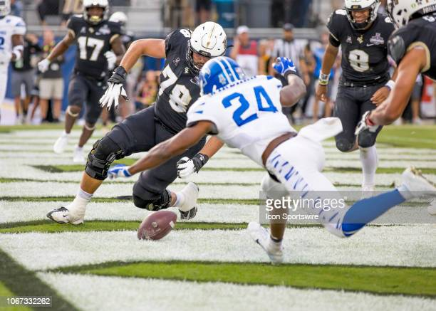 Knights offensive lineman Wyatt Miller dives to save a touchdown during the AAC Championship football game between the UCF Knights and the Memphis...