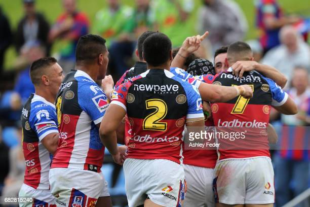 Knights players celebrate a try during the round 10 NRL match between the Newcastle Knights and the Canberra Raiders at McDonald Jones Stadium on May...