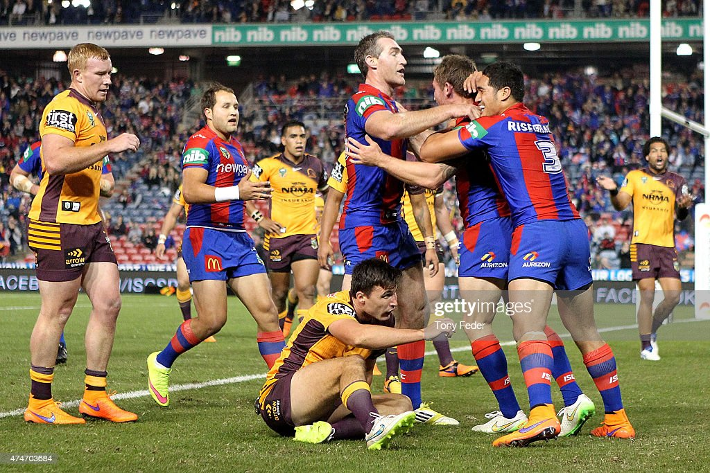 Knights players celebrate a try during the round 11 NRL match between the Newcastle Knights and the Brisbane Broncos at Hunter Stadium on May 25, 2015 in Newcastle, Australia.