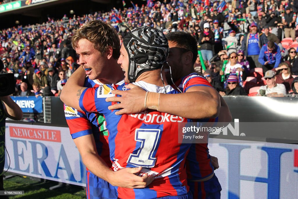 Knights players celebrate a try during the round 15 NRL match between the Newcastle Knights and the Melbourne Storm at McDonald Jones Stadium on June 17, 2018 in Newcastle, Australia.