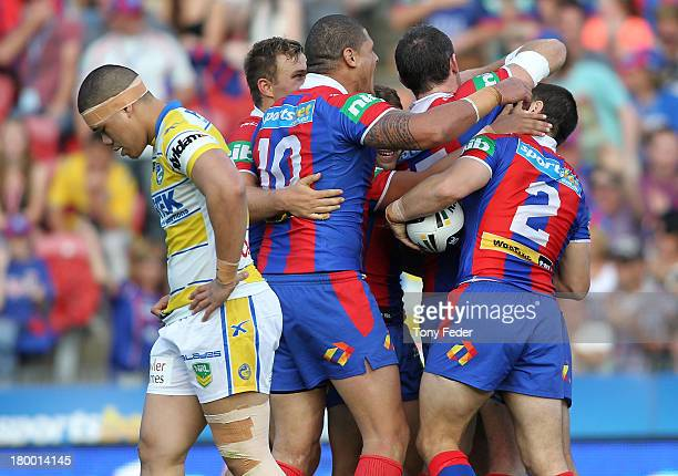 Knights players celebrate a try during the round 26 NRL match between the Newcastle Knights and the Parramatta Eels at Hunter Stadium on September 8,...