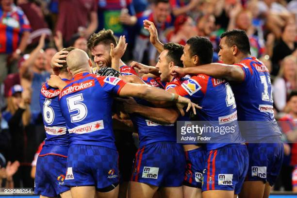 Knights players celebrate a try during the round one NRL match between the Newcastle Knights and the Manly Sea Eagles at McDonald Jones Stadium on...