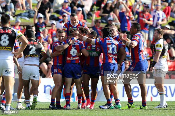 Knights players celebrate a try from Brock Lamb during the round 11 NRL match between the Newcastle Knights and the Penrith Panthers at McDonald...
