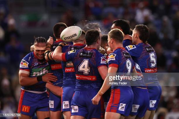 Knights players celebrate a try from Daniel Saifiti during the round 12 NRL match between the Newcastle Knights and the Manly Sea Eagles at McDonald...